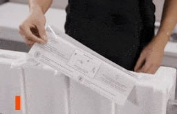 Looping video of someone removing the paper guide from TV packaging